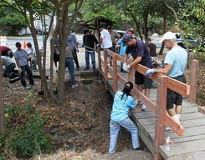 Community Service Day volunteers, Howe Homestead bridge rebuilding