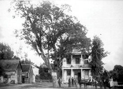 """The Oak Saloon, circa 1880, a popular watering hole, stood where the two roads that formed the center of """"The Corners"""" crossed."""